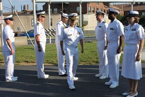 As with Daylight Savings Time, Navy personnel change uniforms from Dress Blues to Dress Whites. During those time frames, all military personnel are subjected to an inspection. Here, Capt. Select Edward J. Sullivan inspects the troops shortly after the transition from Blues to Whites.