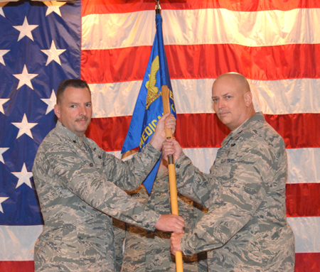 New 81st Medical Group and Keesler Medical Center commander Col. (Dr.) Thomas Harrell, right, accepts the unit guidon from Brig. Gen. Patrick Higby, 81st Training Wing commander, during the March 28 change of command ceremony held in the medical center's Don Wylie Auditorium. The new commander comes to Keesler Air Force Base from Joint Base Elmendorf-Richardson, Alaska, where he commanded the Department of Defense/Veterans Affairs Joint Venture Hospital and also served as the Alaskan Command command surgeon. Former commander Brig. Gen. (Dr.) Kory Cornum has been reassigned to Scott AFB, Ill., as Air Mobility Command command surgeon.