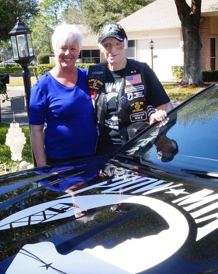 Courtesy Photo Cathy Quigley (Daughter) and John Quigley, stand behind a POWMIA commemorative car owned by Tampa Bay, Rolling Thunder, Florida Chapter 11, U.S. Navy veteran Robert Brinley. (Courtesy Photo provided by Robert Brinley)