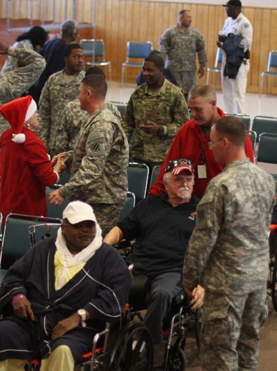 Soldiers of 3rd Infantry Division mingle with veterans at Carl Vinson Veterans Affairs Medical Center, in Dublin, Ga., after a concert by the 3rd ID Band Dec. 9, 2015. (U.S. Army Photo by Sgt. Joshua Laidacker, 2/3 IBCT, Public Affairs/Released)