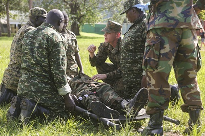 Petty Officer 3rd Class Paxton Dowd, corpsman with Special-Purpose Marine Air-Ground Task Force Crisis Response-Africa, instructs Uganda People's Defense Force medics during a tactical combat casualty care exercise at Camp Singo, Uganda, Nov. 30, 2015. The UPDF medics and corpsmen are training together to improve tactical medical care skills while strengthening the bond between the partner nations. (U.S. Marine Corps photo by Cpl. Olivia McDonald/Released)