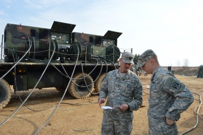 First Sgt. Jon Otis discusses his battery's table VIII certifications with 1st Lt. Nicholas Grace, fire control platoon leader, at Seosan Air Base, South Korea, Dec. 10, 2015. Otis recently overcame a major infection which nearly jeapordized his military career to become a 1st Sgt. with Alpha Battery, 6th Battalion, 52nd Air Defense Artillery Regiment headquartered at Suwon Air Base, South Korea. (U.S. Army Photo by KATUSA Pfc. Yoseup Kim)