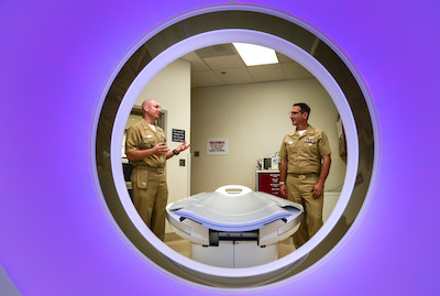SAN DIEGO (Apr. 7, 2017) Lt. Cmdr. Mike Avants (left), explains the benefits of the new CT scanner at the ribbon cutting, with Naval Medical Center San Diego Commanding Officer, Capt. Joel Roos. The instillation of the new CT scanner will allow staff to provide patients with a quicker procedure at the lowest radiation dose possible. (U.S. Navy photo by Mass Communication Specialist 1st Class Elizabeth Merriam/Released)