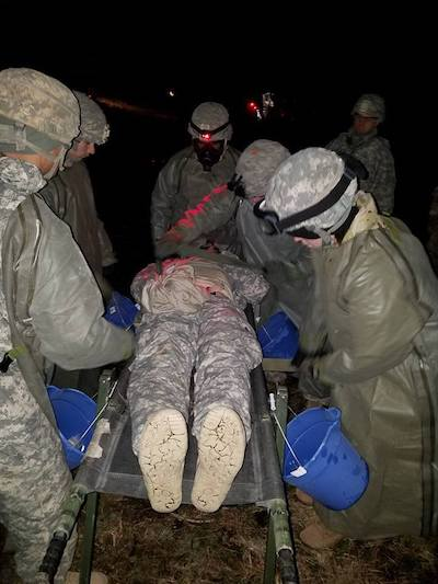 Soldiers from Company C, 296th Brigade Support Battalion, 1st Stryker Brigade, 2nd Infantry Division, decontaminate simulated casualties during a Field Training Exercise on Joint Base Lewis McChord on March 16, 2017. The purpose of the exercise was to test individual performance, evaluate platoon-level leadership, assess critical thinking and build tactical proficiency to set conditions for company validations.