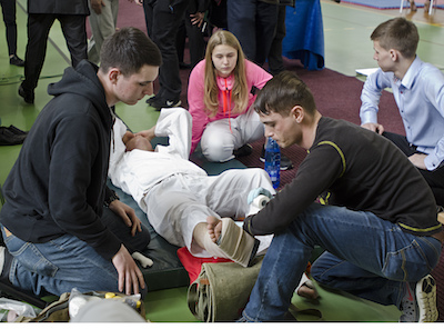 Cpl. Cameron Kinnear and Pfc. Christopher Greco with 3rd Battalion, 29th Field Artillery Regiment, 3rd Armored Brigade Combat Team, 4th Infantry Division, wraps a splint to stabilize a fighters ankle during the Western Poland Open Championship Karate tournament in Ilowa, Poland April 8, 2017. Bravo Battery's priority is to sustain interoperability with the Polish Army, however, tasking U.S. Soldiers to work with a Polish Emergency Medical Service (EMS) team for a local event helps strengthen relationships within Polish communities.